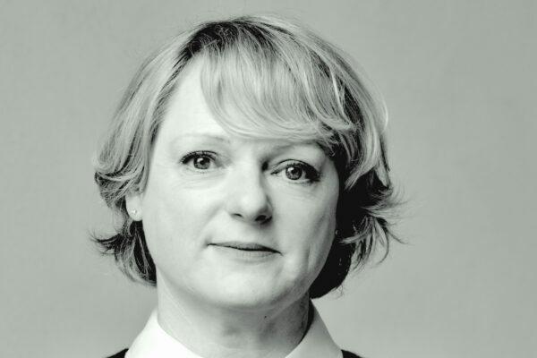 A headshot of the CEO, Sally Meecham