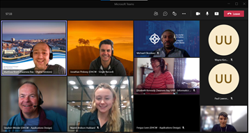 A group of people are on a video call smiling at the camera.